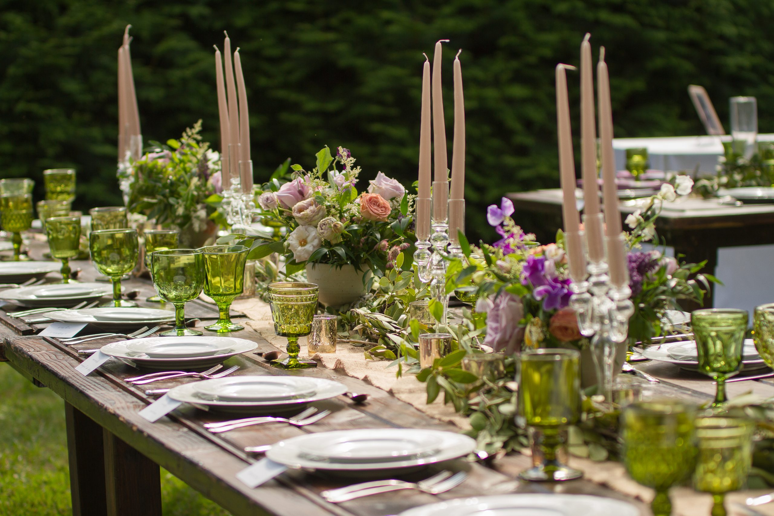 Candlesticks are traditional but easy simple centerpieces. They add height and beauty.