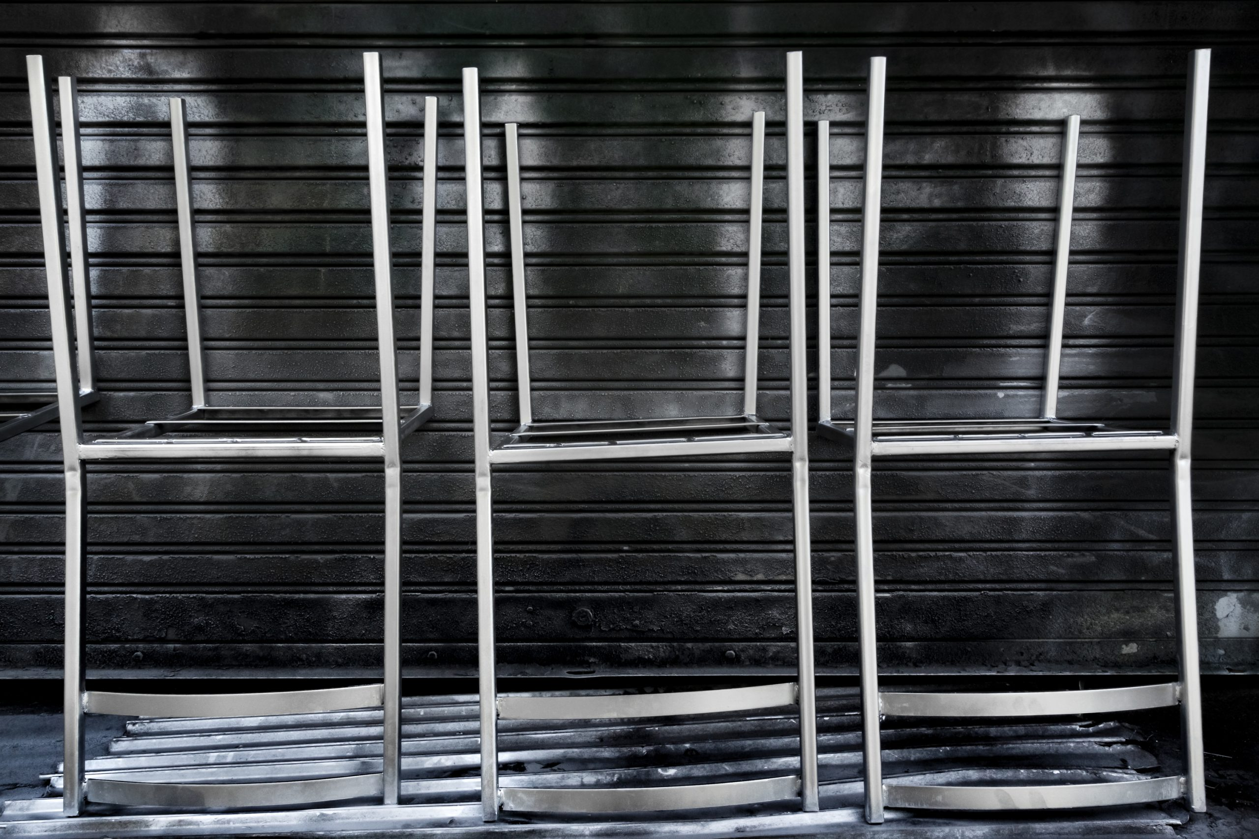 Metal chairs sprayed with a primer. A step about how to paint metal chairs.