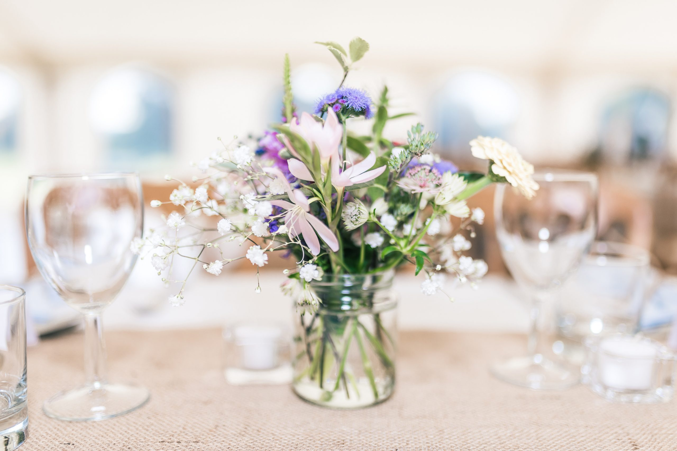 A gorgeous bouquet of delicate flowers in a mason jar makes beautiful simple centerpieces for any event.
