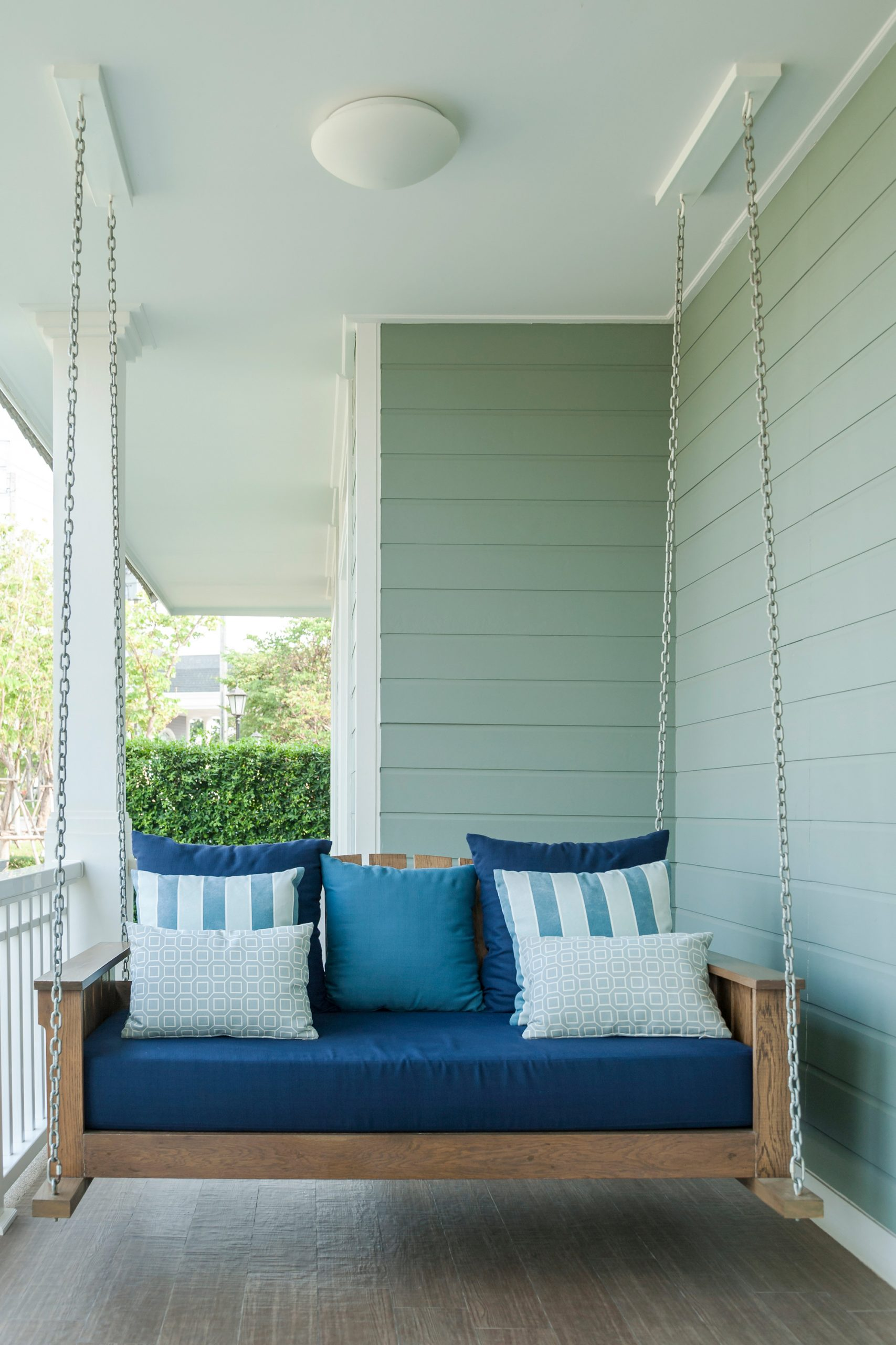 porch swing with lots of pillows