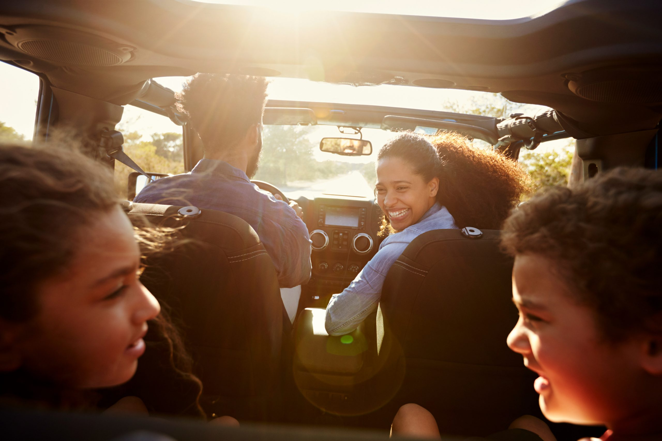 Mom chatting with kids in car. Car hacks for moms.