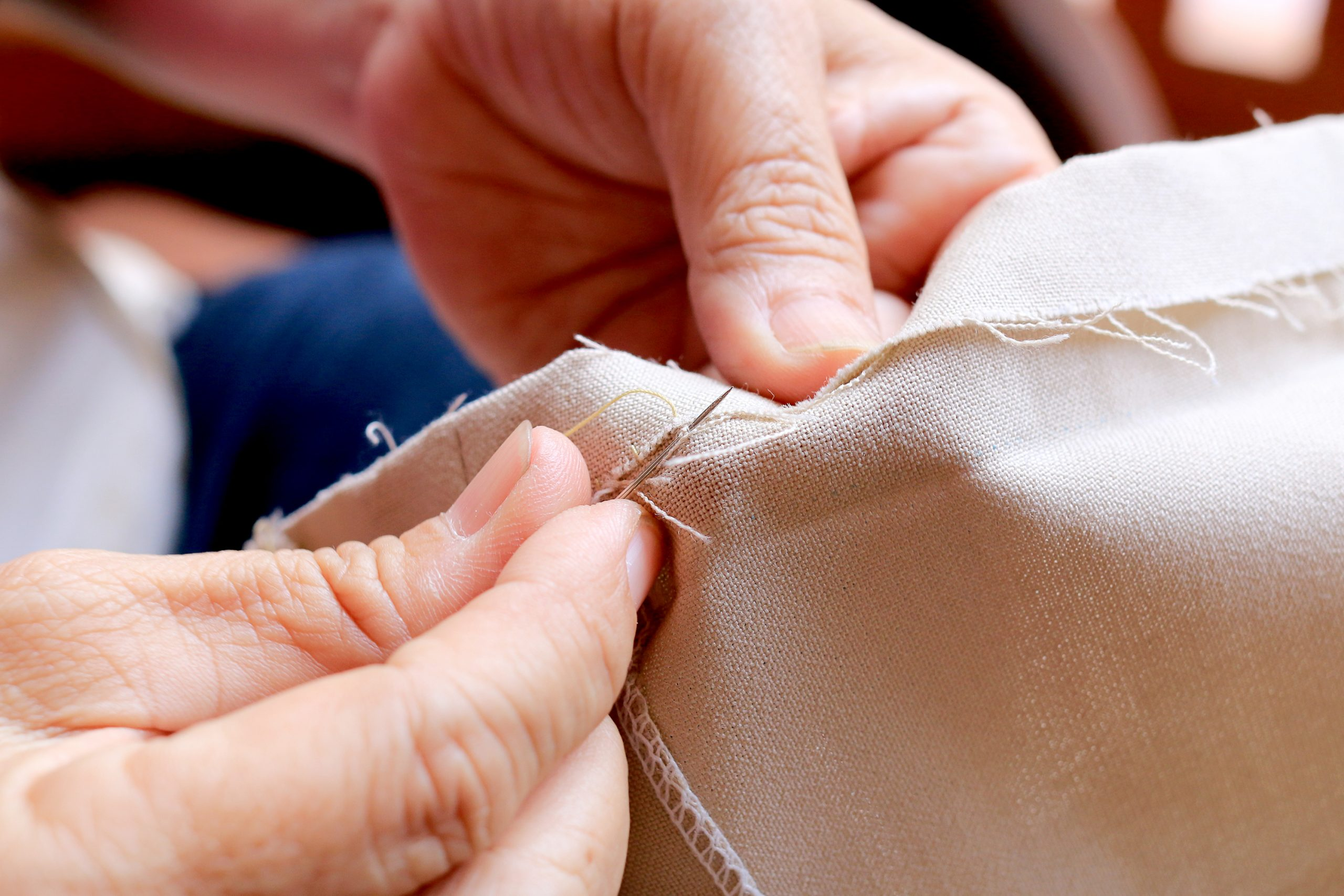 hand sewing a edge on fabric