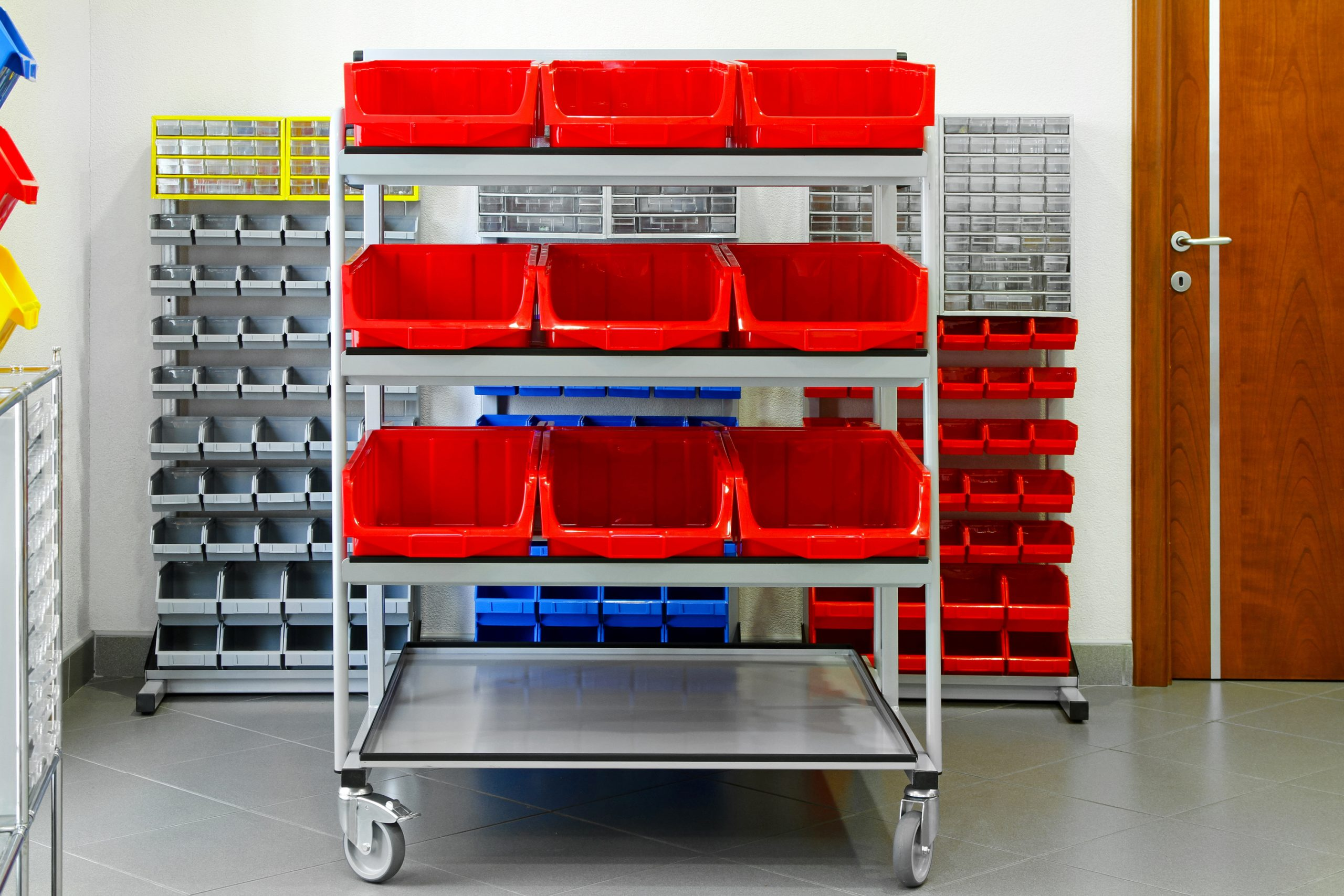 Hardware bins that were added to a garage. As fas as garage makeovers go, this is easy, but also makes such a clean look keeping everything so organized.