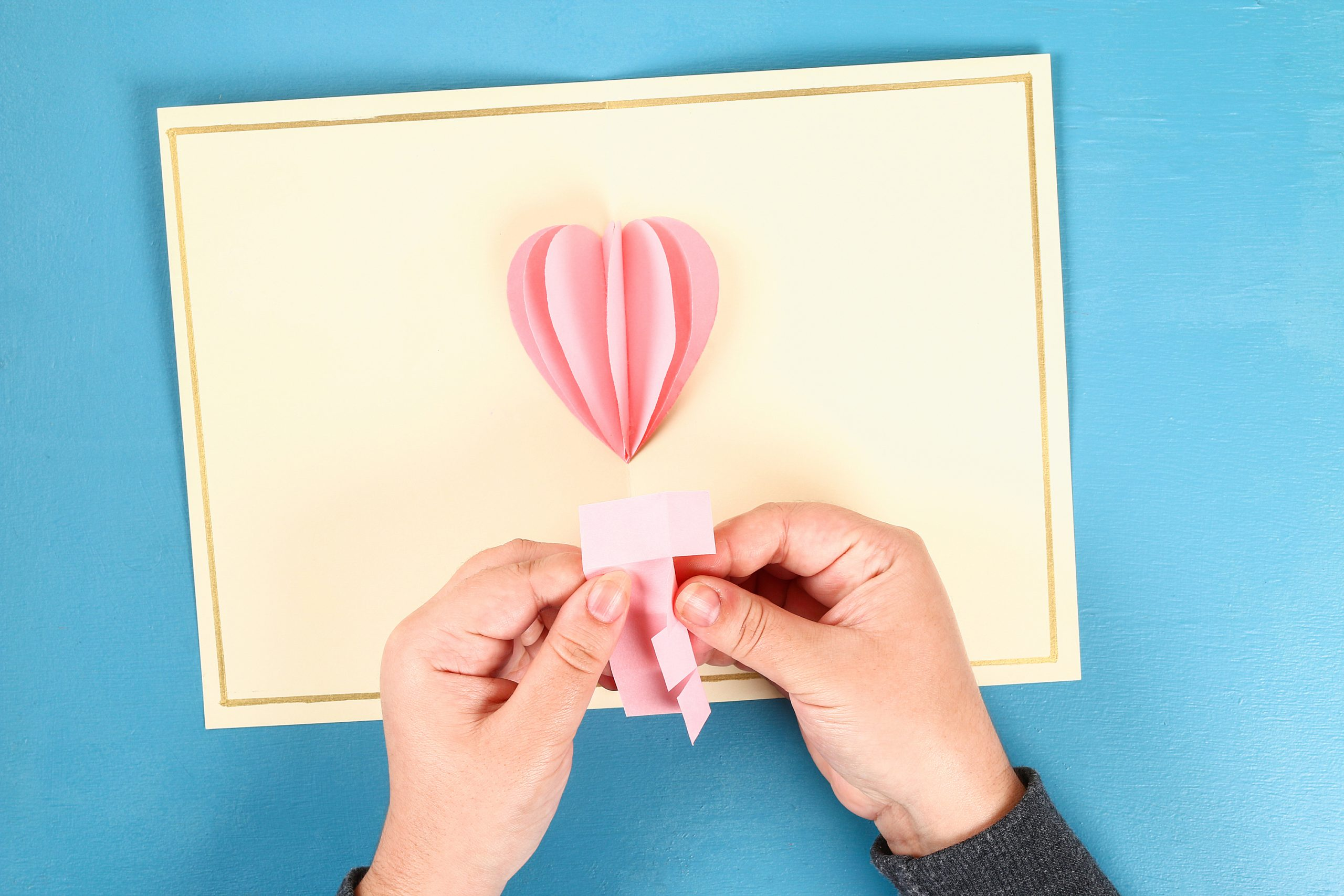 Pink folded paper heart. Diy ideas for Dollar Store Valentines.