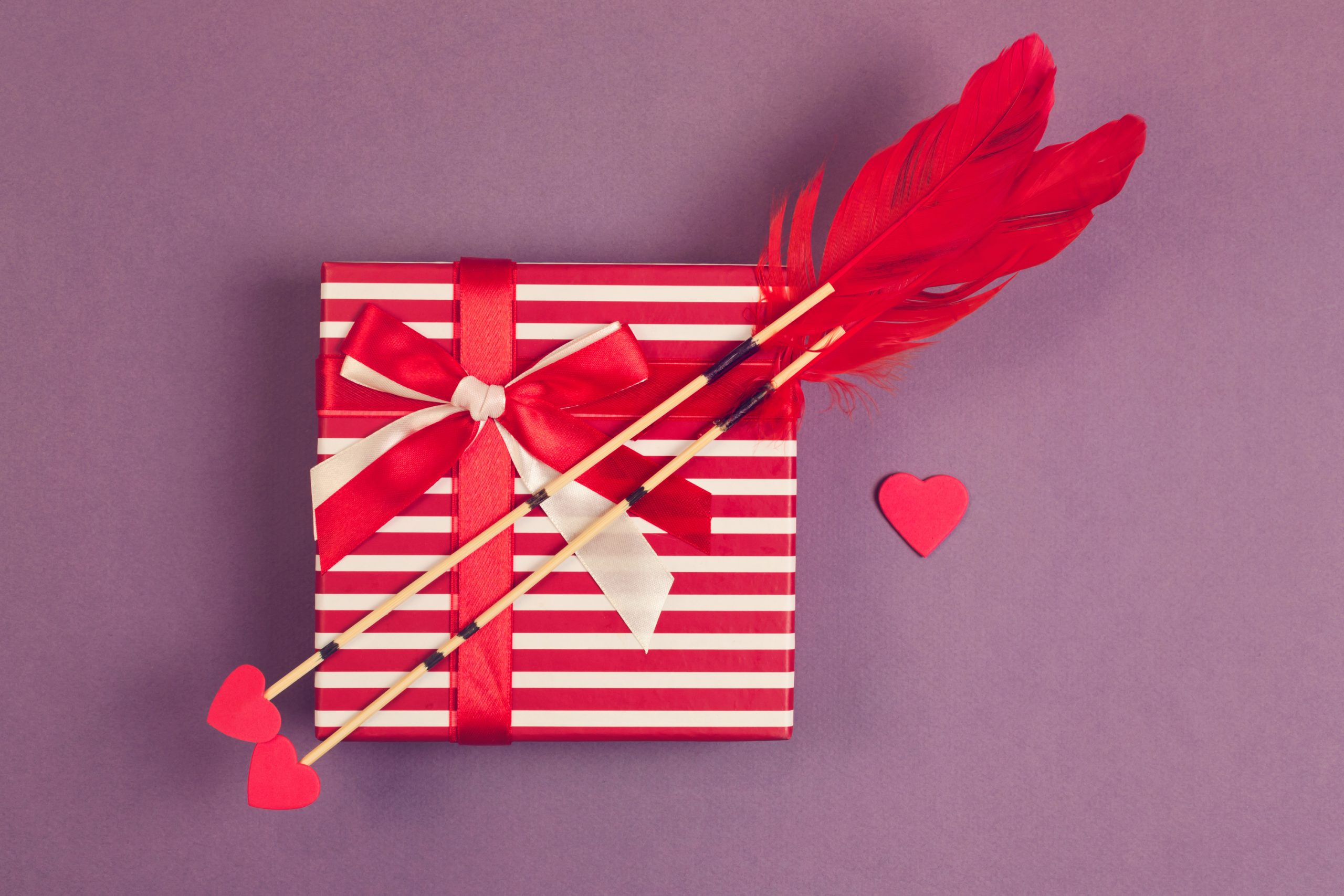 DIY arrows made with heart shape tips and red feathers. Super cute Dollar Store Valentines.