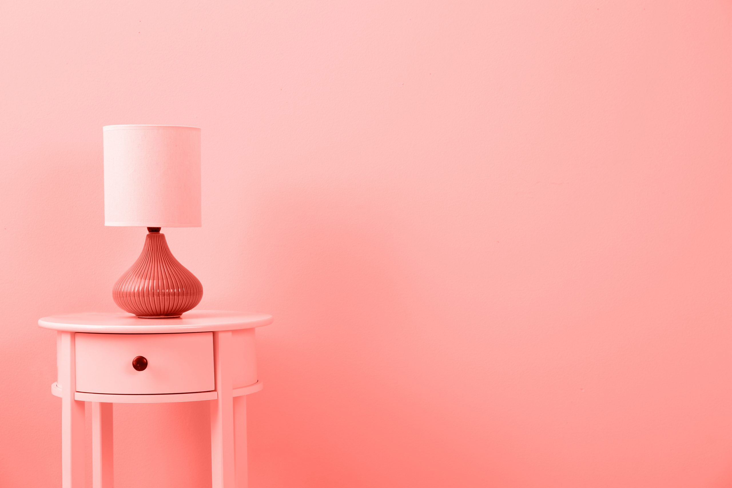 A painted lampshade from the Dollar Store. It was a simple change from white to pale pink which matched the color of this room. Who would have thought a lampshade was such an easy way to beautify your home.