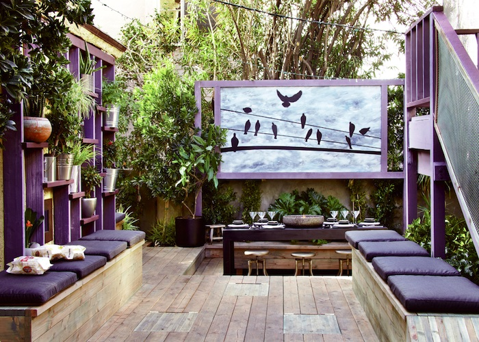 Colorful-outdoor-patio-design-with-beautiful-dining-on-wooden-flooring