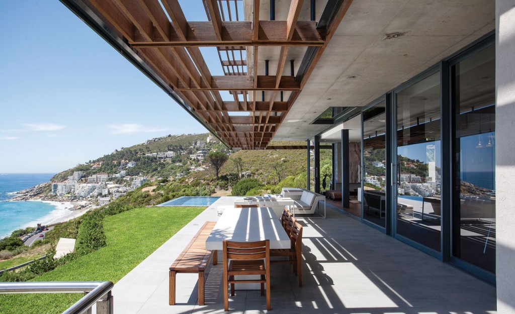 Modern-outdoor-dining-area-with-white-long-dining-table-and-wood-chairs