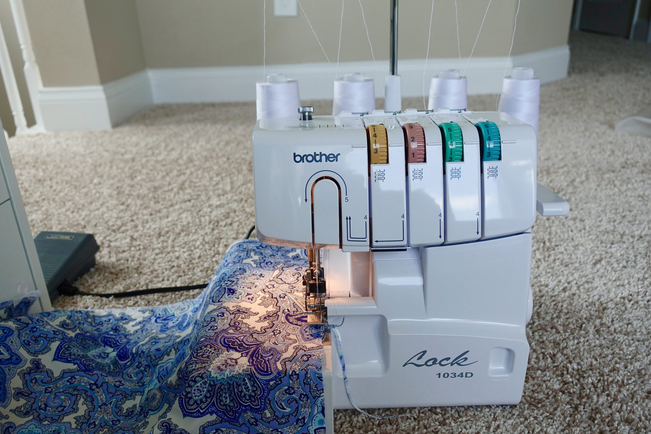 Adjusting the tension on a serger is one of the serger hacks mentioned in this article.