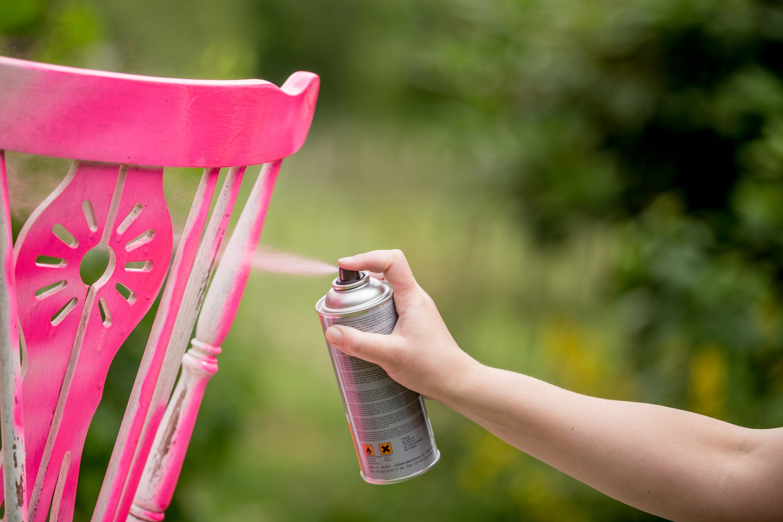 Tips about how to spray paint wood furniture! This example shows a wood chair being painted.