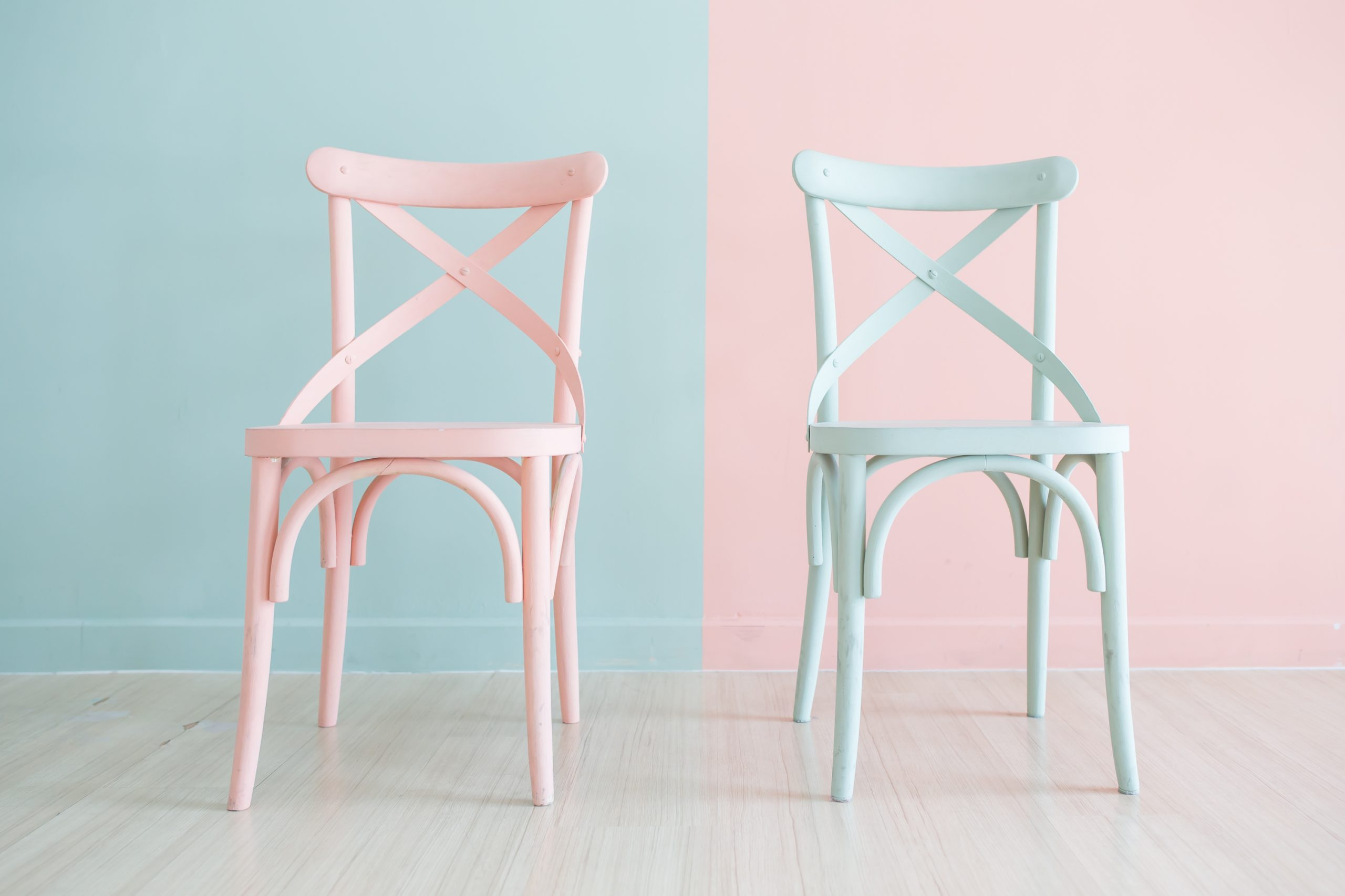 Two chairs that have been spray painted. Learn how to spray paint furniture in this article.