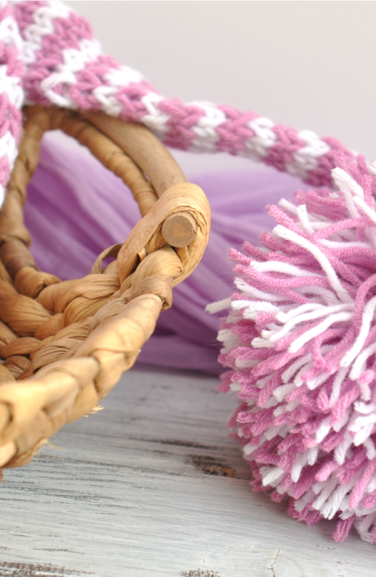 Keep your home organized and totally stylish with this easy tutorial for a boho DIY basket with pom poms. Believe it or not, this is such an easy DIY project that you could make more than one in no time at all. Check it out!