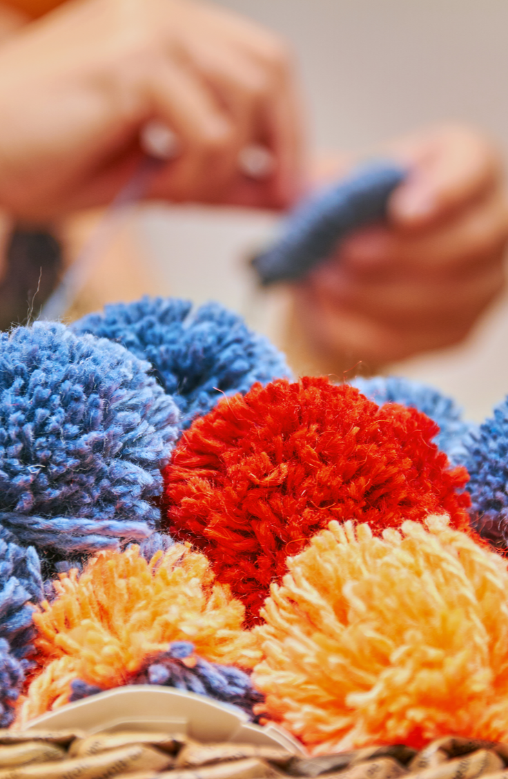 Keep your home organized and totally stylish with this easy tutorial for a boho DIY basket with pom poms. Believe it or not, this is such an easy DIY project that you could make more than one in no time at all. And the best part is, they're totally customizable!