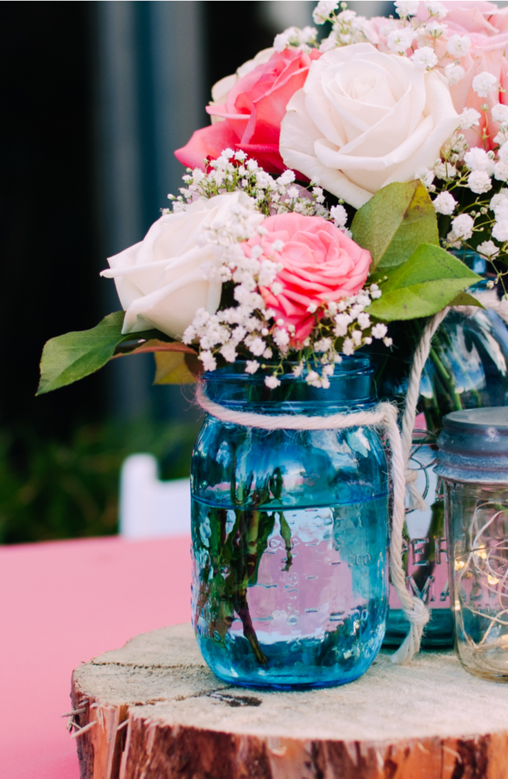 it's time for awesome DIY summer mason jar ideas! Mason jars are the perfect summertime centerpieces. Just add some flowers and tie some twine around them!